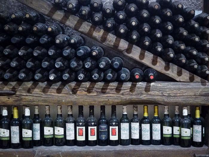 Row of wine bottles on rack