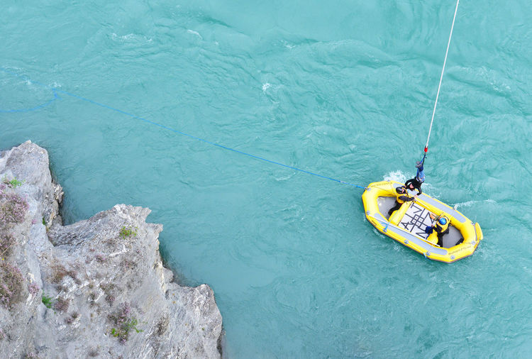 Person during bungy jump,New Zealand Adventure Beauty In Nature Blue Bungy Jumping Commercial Day Elevated View Kawarau Bridge Leisure Activity Lifestyles Nature New Zealands Outdoors Queenstown Rippled Scenics Tranquil Scene Tranquility Vacations Water Yellow Zealands