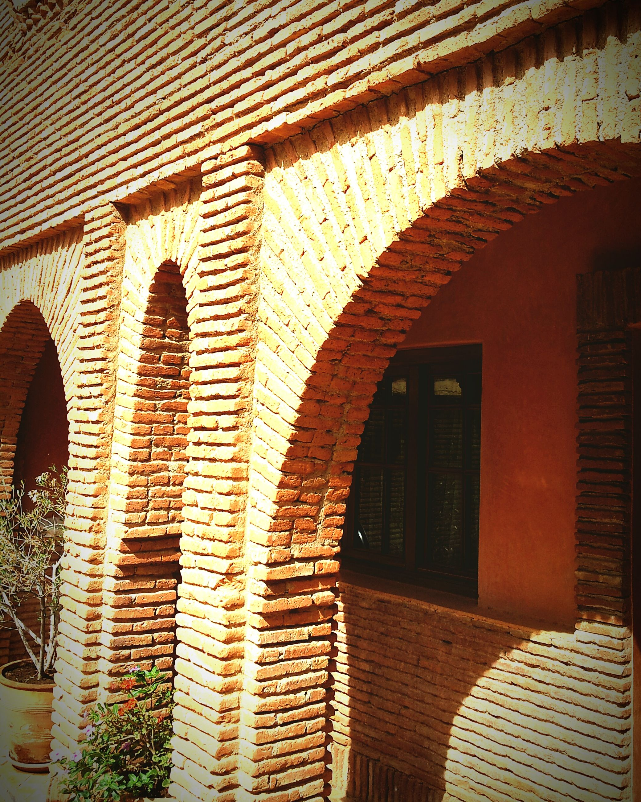 architecture, built structure, arch, building exterior, window, brick wall, building, residential building, residential structure, house, wall - building feature, no people, steps, day, old, sunlight, outdoors, in a row, wall