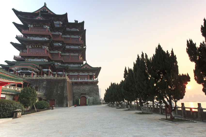 Nanchang, China - December 30, 2015: Tengwang Pavilion in Nanchang at sunset, one of the four famous towers in south China Architecture ASIA Built Structure China Chinese New Year Cultures Diminishing Perspective Footpath In A Row Jianxi Metropolis Modern Building Nanchang Outdoors Pagoda Pavilion On Lake Province Sky Temple - Building Tengwang The Way Forward Tourism Travel Destinations Tree Walkway