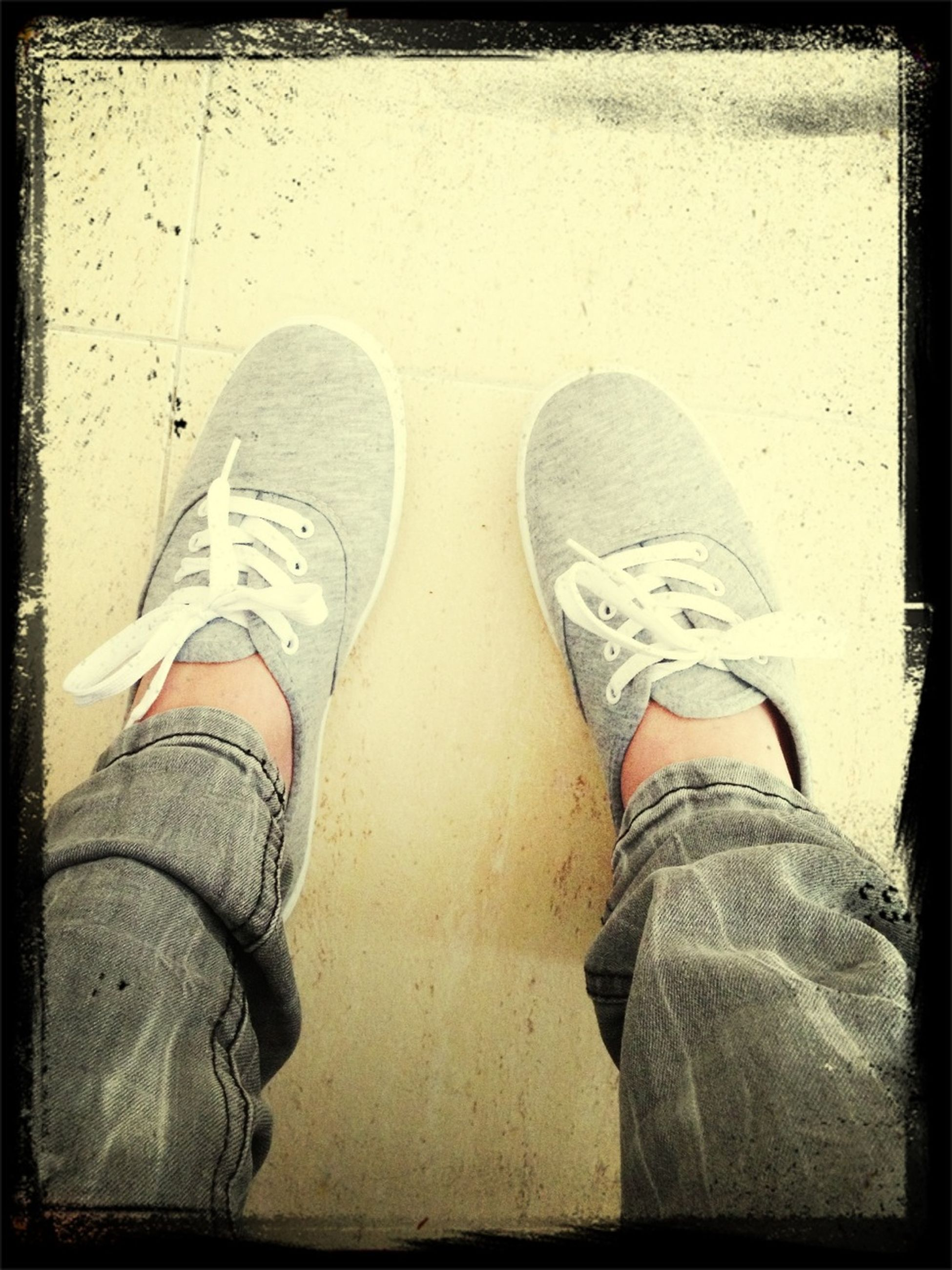 low section, person, shoe, personal perspective, transfer print, footwear, human foot, auto post production filter, lifestyles, jeans, standing, men, canvas shoe, high angle view, part of, leisure activity, indoors