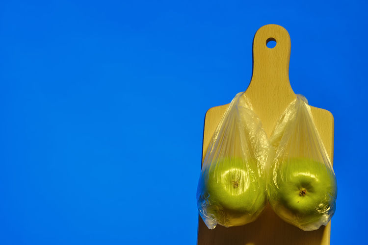 Close-up of yellow toy against blue background