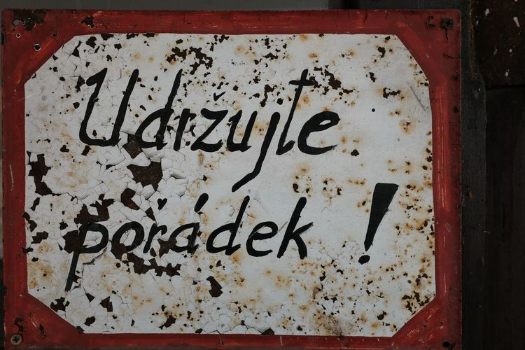 Close-up of text on old metal
