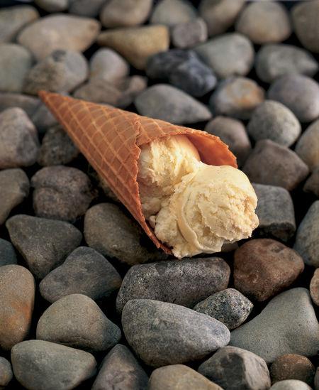 Close-up of ice cream on pebbles
