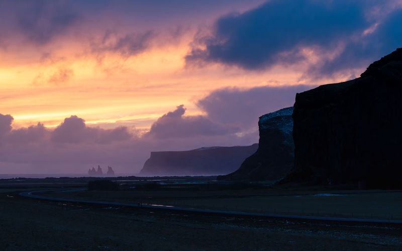 Coastline close to Vik during sunset, Iceland Sky Sunset Beauty In Nature Scenics - Nature Cloud - Sky Tranquil Scene Tranquility Mountain Nature No People Idyllic Non-urban Scene Outdoors Vík í Mýrdal Vik Iceland Europe Coast Coastline Landscape Nature Scenics Scenery Cliff Travel Destinations Tourism Sundown Panorama Panoramic Countryside
