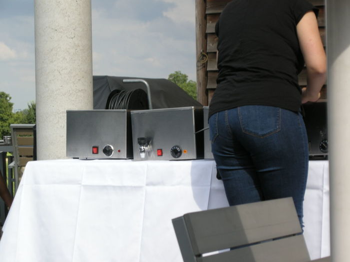 Midsection of woman standing by equipment on table in yard