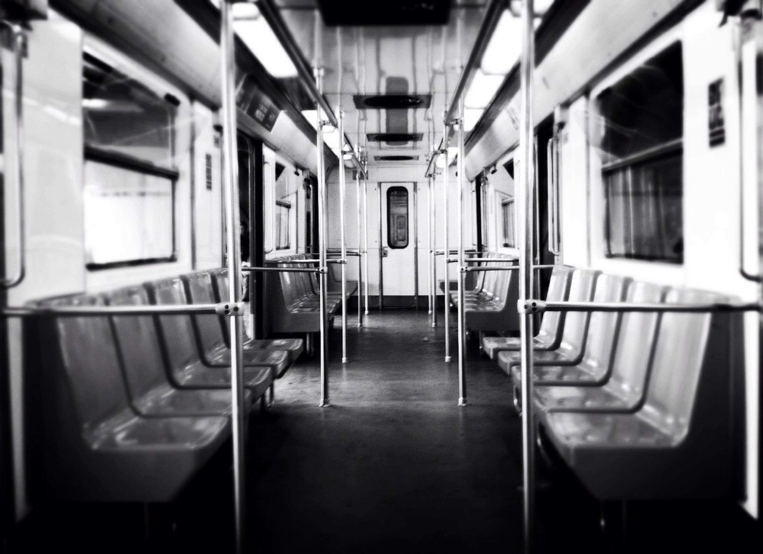 indoors, window, absence, empty, vehicle seat, transportation, interior, vehicle interior, public transportation, reflection, chair, architecture, no people, in a row, built structure, mode of transport, day, technology, passenger train, train - vehicle