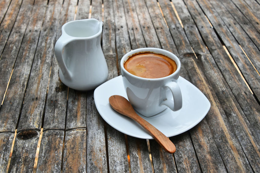 Espressoo coffee shot with milk on bamboo table, close up Bamboo Black Close-up Cofeine Coffee Coffee - Drink Coffee Cup Coffee Time Day Drink Drinks Energy Espresso Espresso Shot Food And Drink Freshness Hot Drink Milk No People Outdoors Refreshment Small Table Vintage Wood - Material