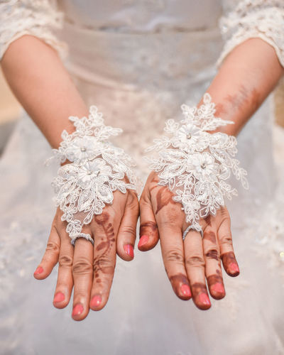 Midsection of bride wearing gloves