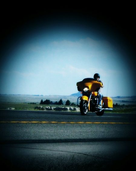 Bright colored bike Headin Out On Highway 85 North Coming Out Of Lusk Wyoming Headed To Sturgis All Kinds & Sizes Of Bikes Thousands Of Bikers Go Through Town