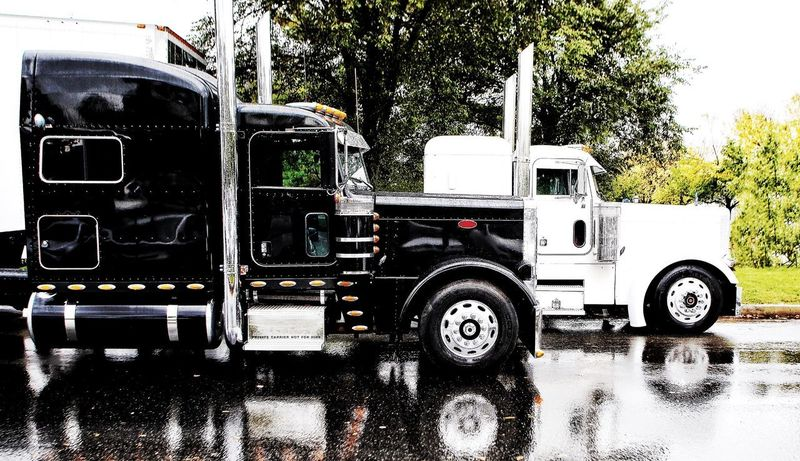 Trucks ready for their million dollar antique cargo. JGLowe Transportation Mode Of Transportation Tree Land Vehicle Plant Nature No People Day Motor Vehicle Outdoors Travel Stationary Truck Sky Sunlight Semi-truck Industry