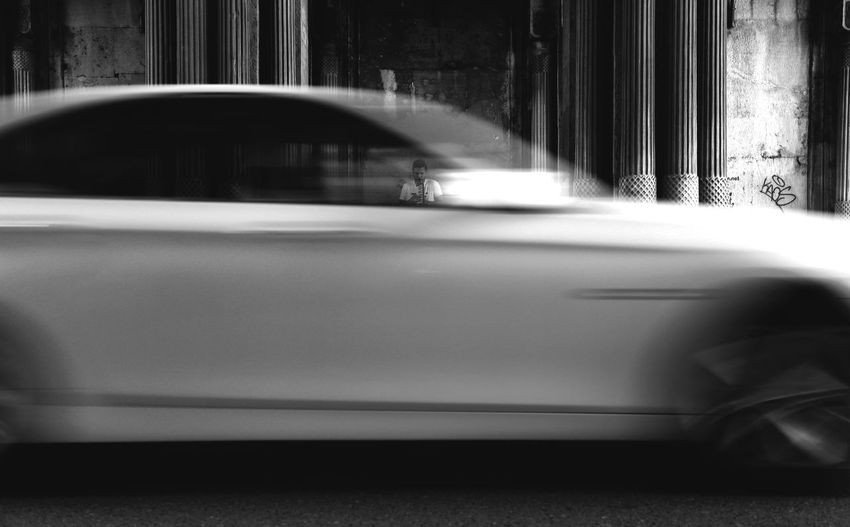 Blurred motion of car on street in city