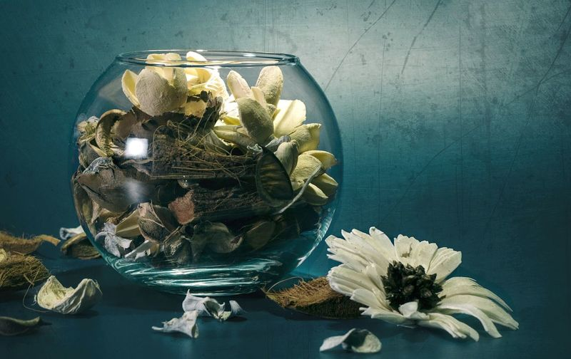 Close-up of flowers in fishbowl on table