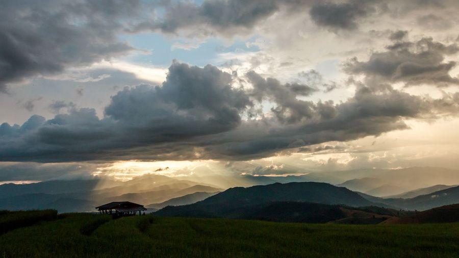 ChangmaiThailand Thailand Beauty In Nature Cloud - Sky Environment Field Holylight Idyllic Land Landscape Mountain Mountain Range Nature No People Non-urban Scene Outdoors Plant Scenics - Nature Sky Sunbeam Tranquil Scene Tranquility