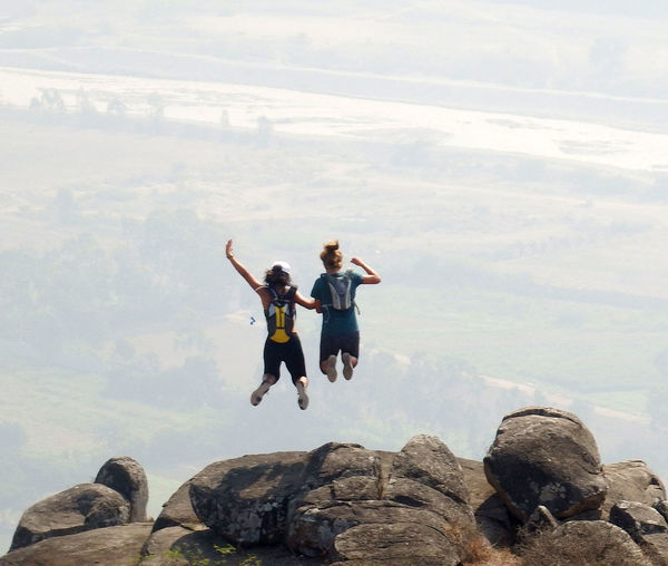 Free falling Jump Activity Adventure Freedom Girls Jumping Mountain Nature Outdoors Rock Scenics - Nature Sky