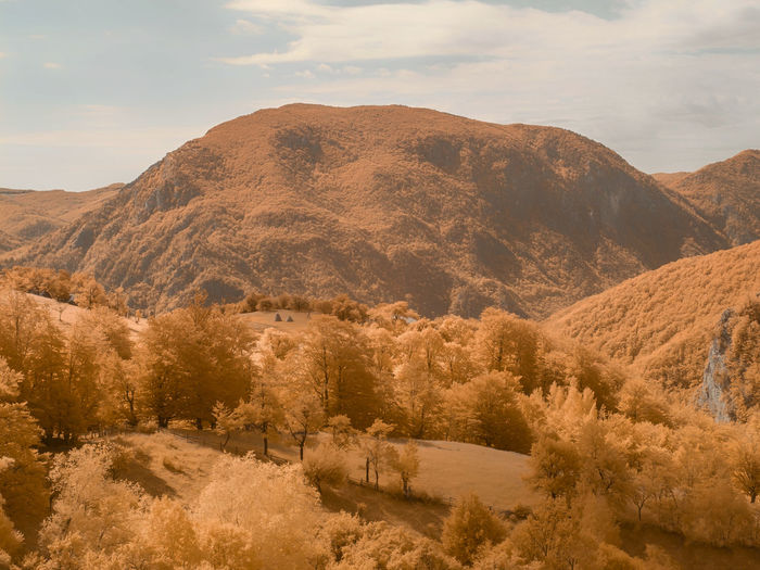 Scenic view of infrared landscape and mountains against sky
