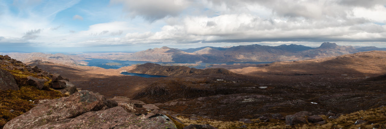 Panoramic view of mountain landscape against sky. - Scotland, 2016 Exploring Hiking Cloud - Sky Mountain Sky Scenics - Nature Environment Landscape Mountain Range Beauty In Nature Nature Rock Land Travel Destinations No People Day Tranquil Scene Solid Tranquility Rock - Object Outdoors Non-urban Scene Mountain Peak Semi-arid Arid Climate Loch Maree Panorama Scotland Highlands Scotland Wild Landscape Horizon Over Land The Great Outdoors - 2019 EyeEm Awards