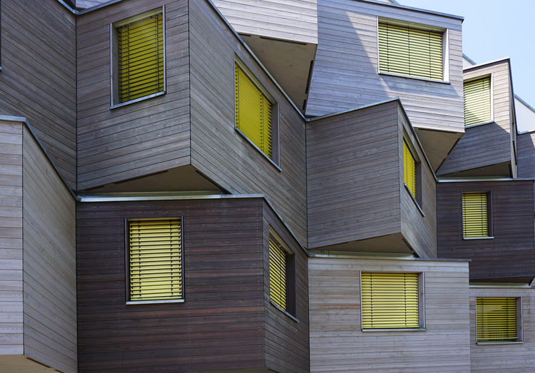 students home in Berlin Marzahn Yellow Modern Architecture Residential District No People Wooden Material Glass - Material Windows In A Row Pattern Living Berlin Students