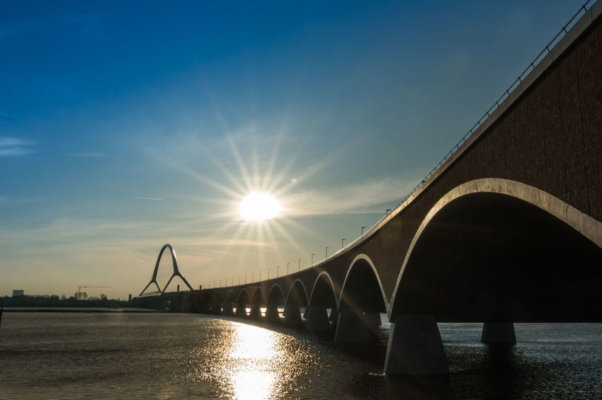 The Netherlands Waalbrug Nijmegen Arch Arch Bridge Architecture Betuwe Bridge Bridge - Man Made Structure Built Structure Connection Engineering Holland Lens Flare Nature Outdoors Oversteek River Sky Sun Sunlight Sunset Transportation Water Waterfront