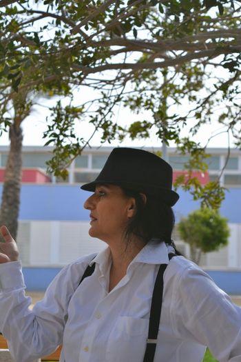 Woman Wearing Suspenders Standing Below Tree