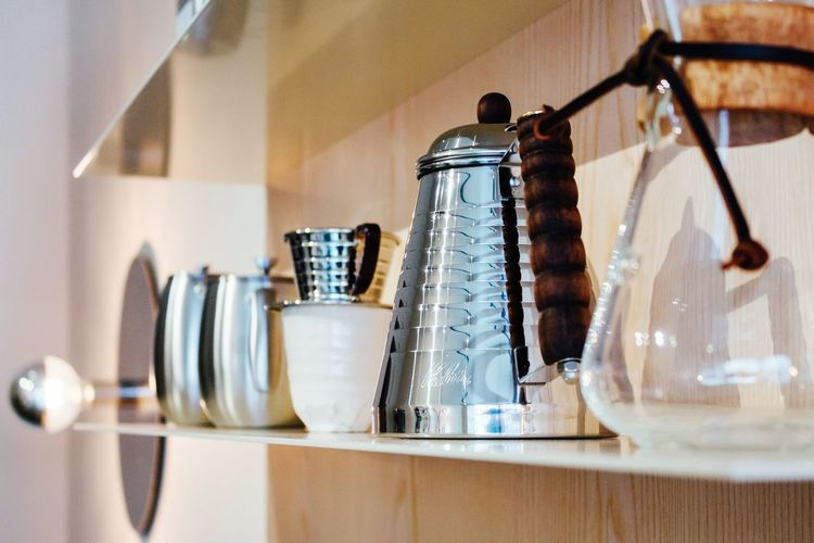 Kettle And Containers On Kitchen Counter In Coffee Shop