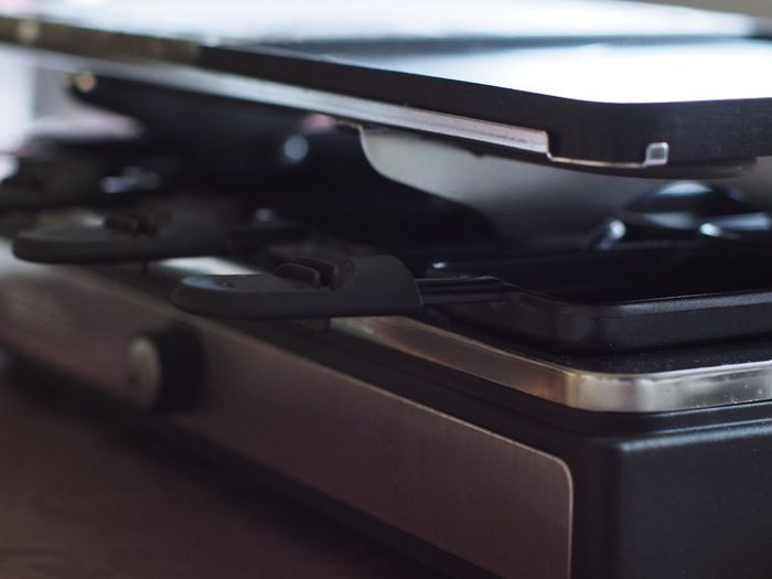 Grill Grilled Raclette Raclette Cooking Close-up No People Indoors  Retro Styled Selective Focus Metal Arts Culture And Entertainment Day Focus On Foreground Black Color Technology Reflection Design Handle Equipment Mode Of Transportation Music Side View