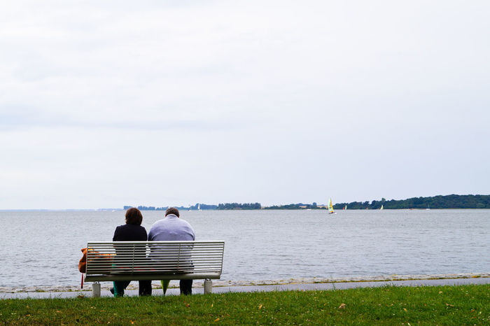 Adult Beach Close To Community Outreach Day Horizontal Lake Men Nature Only Men Outdoors People Person Sitting Sky Togetherness Tranquil Scene Two People Water Young Adult