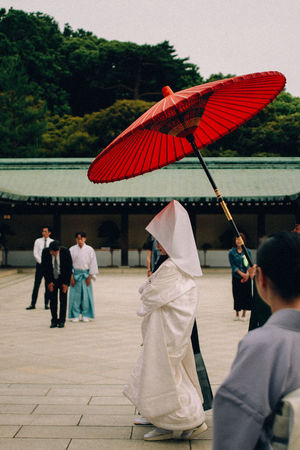 Bowing Ceremony Day Group Of People Japanese Dress Japanese Wedding Kimono Meiji-Jingu Outdoors Red Umbrella Shinto Wedding Wedding Ceremony Wedding Dress White