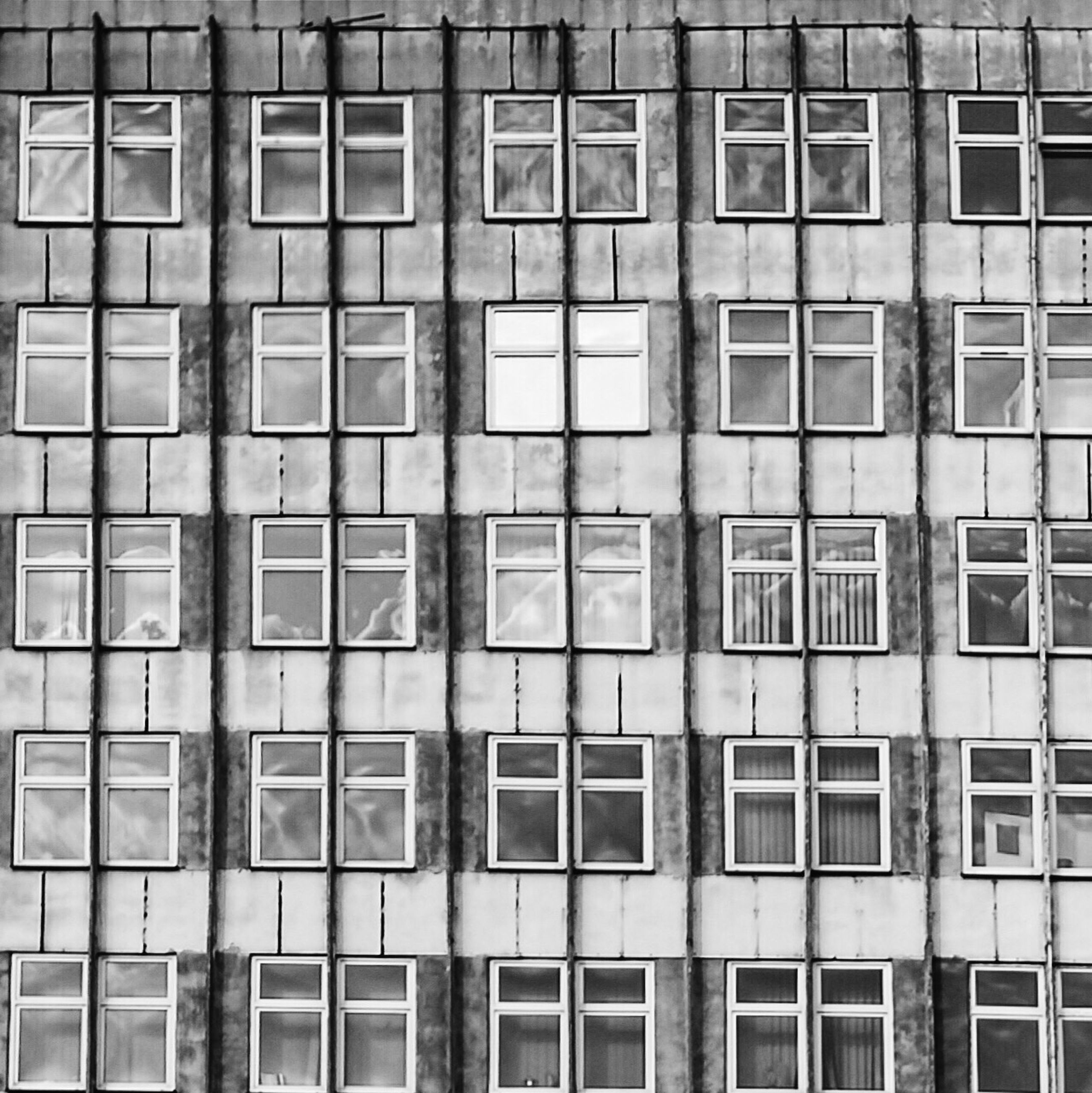 full frame, backgrounds, architecture, window, building exterior, built structure, repetition, in a row, building, pattern, side by side, glass - material, city, low angle view, apartment, residential building, no people, day, residential structure, outdoors
