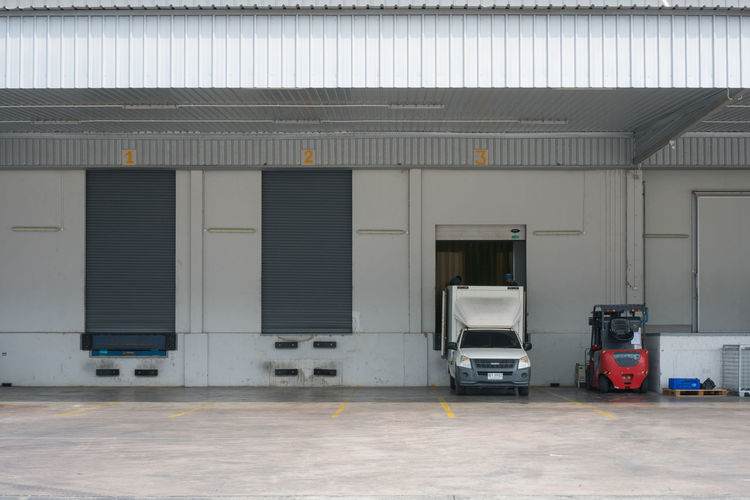 Architecture Built Structure Transportation Entrance Building Mode Of Transportation Building Exterior Land Vehicle Door Business Day Distribution Warehouse No People Industry Domestic Room Warehouse Freight Transportation Truck Outdoors Loading Dock Garage