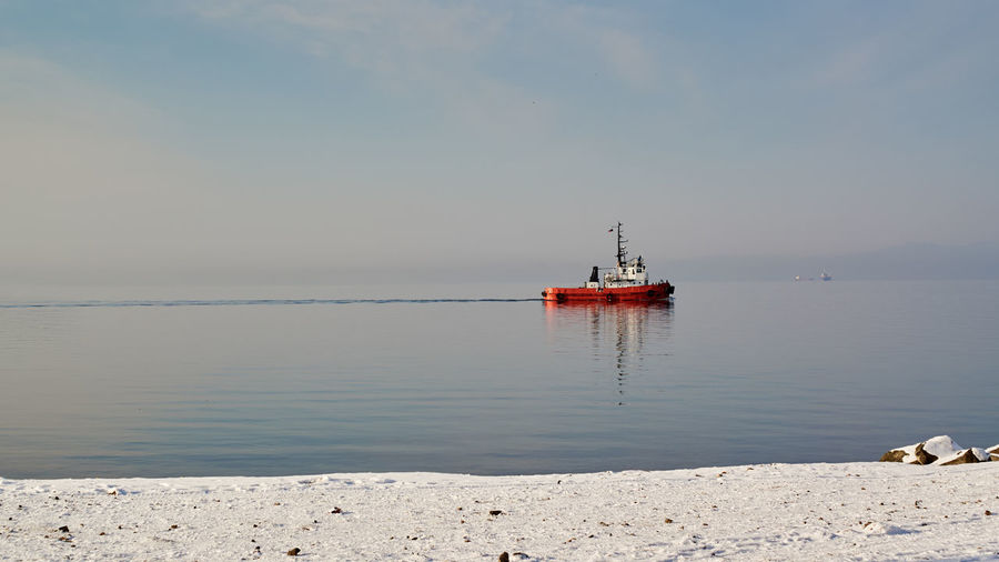 Tugboat on sea. Spring. Tugboat Boat Weather Amur Bay Vladivostok Spring Photography Themes Sea Business Nautical Vessel Beach Point Of View Clear Sky Seascape Coast Calm Coastline