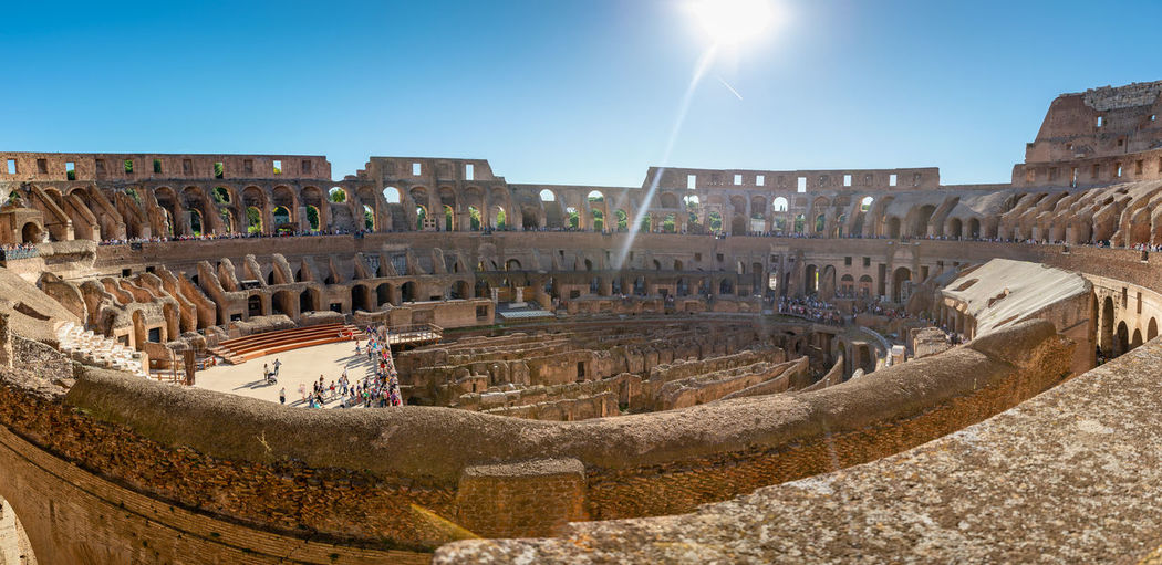 Colloseum In Rome Amphitheater Ancient Ancient Civilization Archaeology Architecture Built Structure Colloseo Colloseum Day History Lens Flare Old Ruin Ruined Sky Sun Sunbeam Sunlight The Past Tourism Travel Travel Destinations