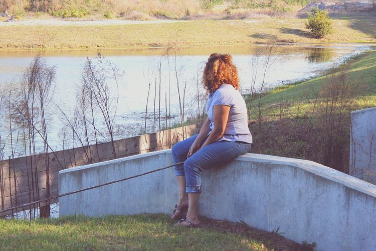 Peaceful morning, great for reflecting... Pond Pondering Reflecting On Life Young Women Water Full Length Sitting Women Redhead Beautiful Woman Long Hair Sky Grass Hair Toss Pensive Thoughtful Thinking Boho Human Hair Tousled Hair