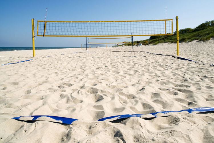 Empty beach volleyball court Holiday Absence Beach Beach Volleyball Day Goal Post Land Nature Net - Sports Equipment No People Outdoors Sand Sky Sport Sports Equipment Summer Sunlight Team Sport Tranquility Volleyball - Sport