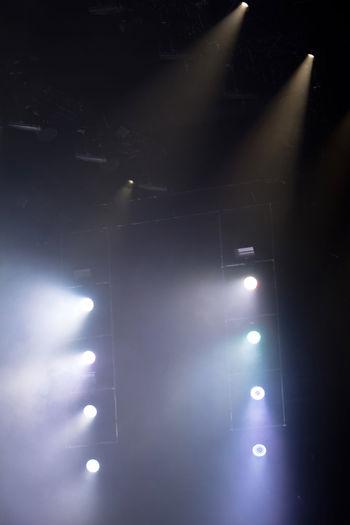 Low angle view of illuminated lights at night