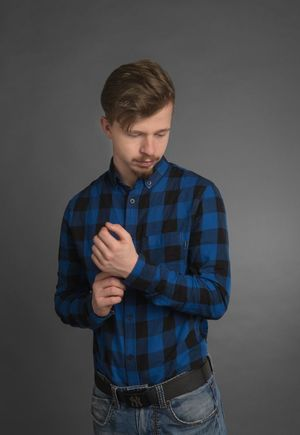 EyeEm Selects Studio Shot Young Adult Casual Clothing Front View Young Men Waist Up One Person Standing Gray Background One Young Man Only Portrait Real People Human Hand People Lifestyles Indoors  Day Fashion Stories