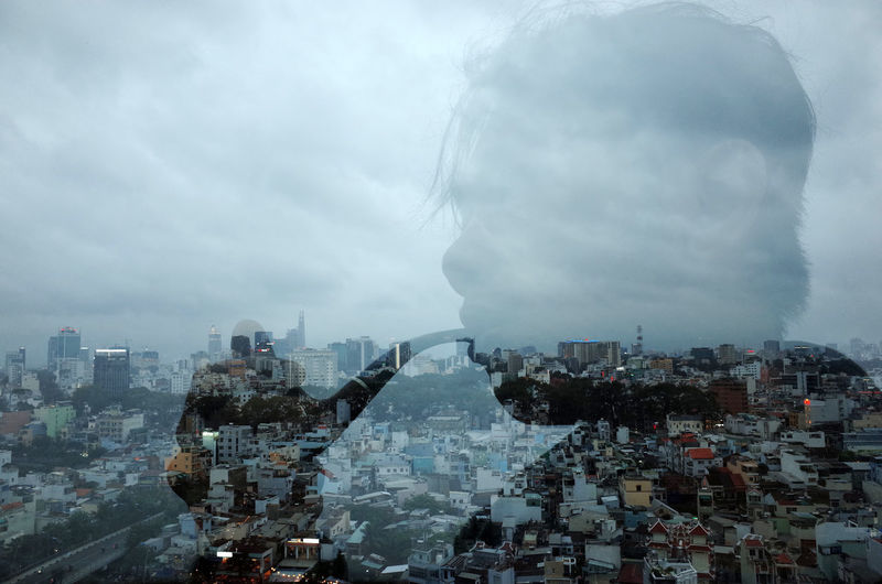 Digital composite image of buildings and city against sky