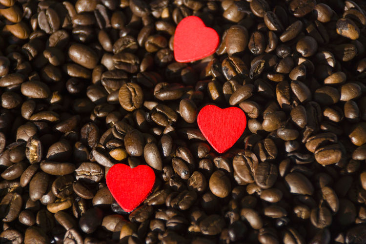 Heart shape decorations on roasted coffee beans