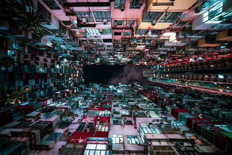 Digital composite image of illuminated buildings in city at night