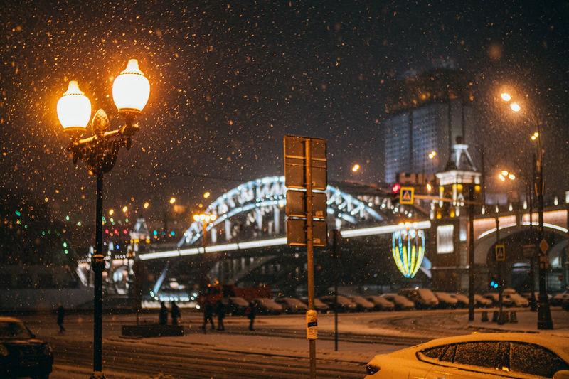 Illuminated city at night during winter