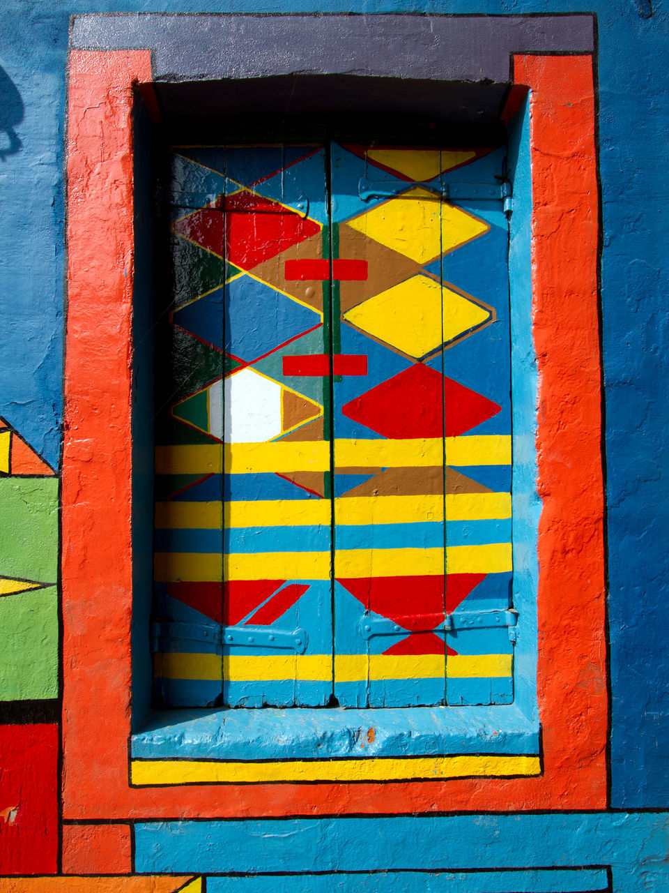 multi colored, yellow, vibrant color, no people, day, outdoors, red, flag, architecture, built structure, painted, paint, blue, backgrounds, full frame, close-up, building exterior