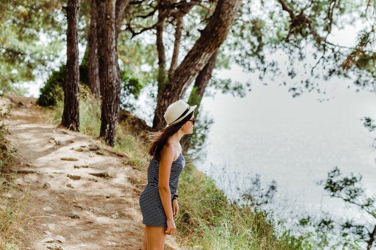 summer girl Girl Hair Turkey Summertime Sea Seascape Hat Summertime Wind Tree Tree Trunk Full Length Sky Landscape Sun Hat Woods Lakeside
