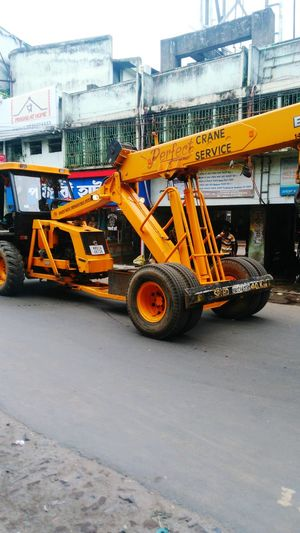 A Big Crane At Road