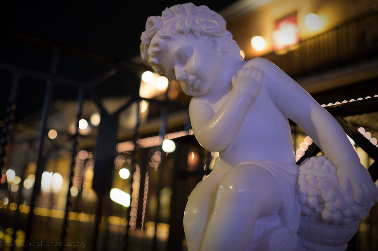 Close-Up Of Statue In City At Night