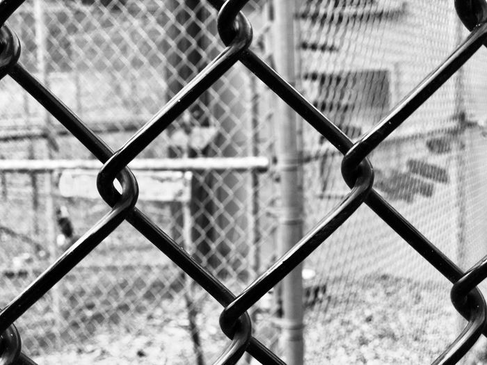 Chainlink Fence Fence Protection Safety Security Focus On Foreground Metal Close-up No People Locked Out Enclosure Black And White Black And White Photography Fences & Beyond Metal Fence Metal Industry Metalwork Locked Up Contained Imprisoned Trapped Black And White Collection  EyeEmNewHere