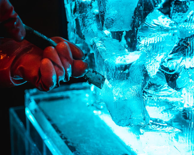 Close-up of hand carving ice
