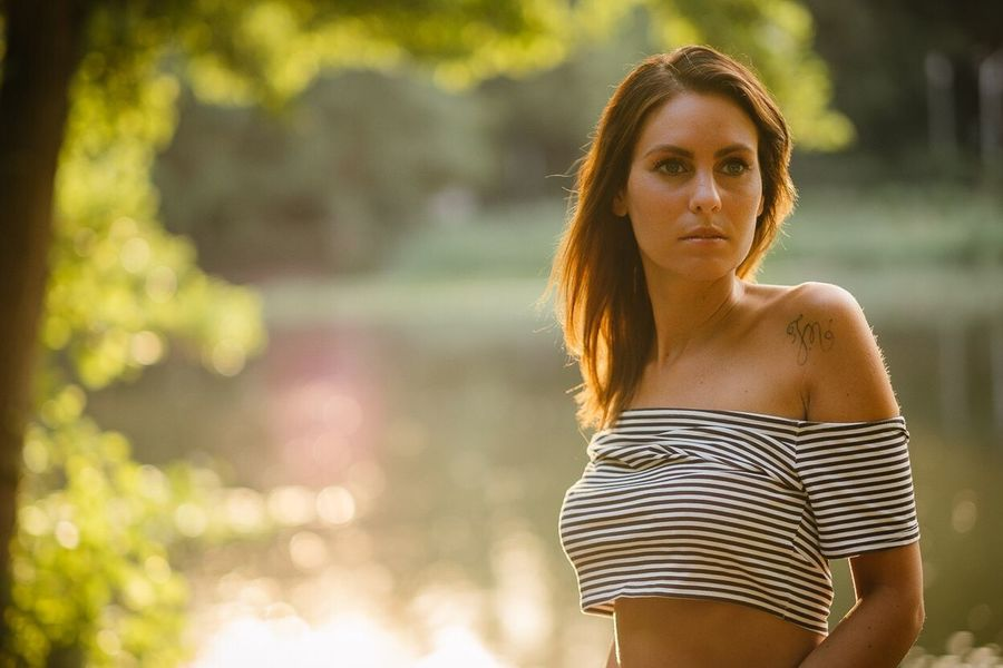 Real People Focus On Foreground Beautiful Woman One Person Standing Young Adult Leisure Activity Young Women Lifestyles Outdoors Looking At Camera Portrait Day Nature Tree Abdomen People
