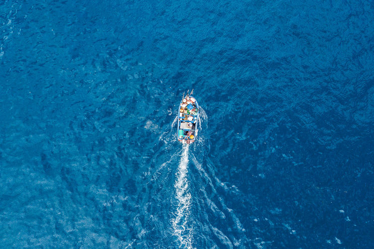 A top view of a fishing boat sailing. Aerial Shot Drone  Fishing Equipment Above Aerial Photography Aerial View Blue Day Drone Photography Fishing Fishing Boat Fishing Industry Fishing Time High Angle View Lifestyles Mode Of Transportation Motion Ocean Outdoors Sailing Sailing Boat Sea Transportation