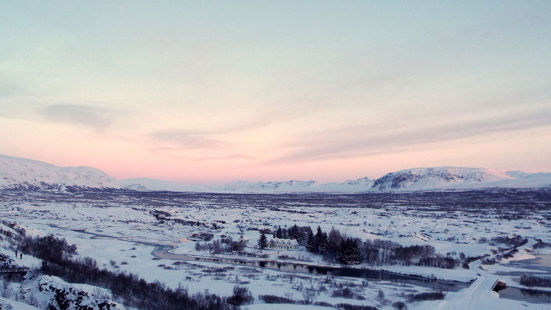 Beauty In Nature Cold Temperature Day Frozen Golden Circle Iceland Landscape Mountain Nature No People Non-urban Scene Outdoors Pingvellir Scenics Sky Snow Sunset Tranquil Scene Tranquility Weather Winter