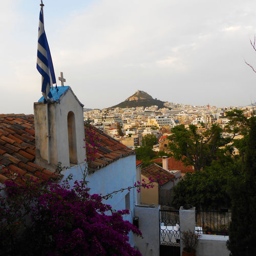 Una vista del Monte Licabetto Atene Athens City Athens, Greece Travelling Architecture Athens City Cityscape Cloud - Sky Day Flag Nature Outdoors Patriotism Photography Place Of Worship Plant Religion Residential District Sky TOWNSCAPE Travel Destinations Travelphotography Tree